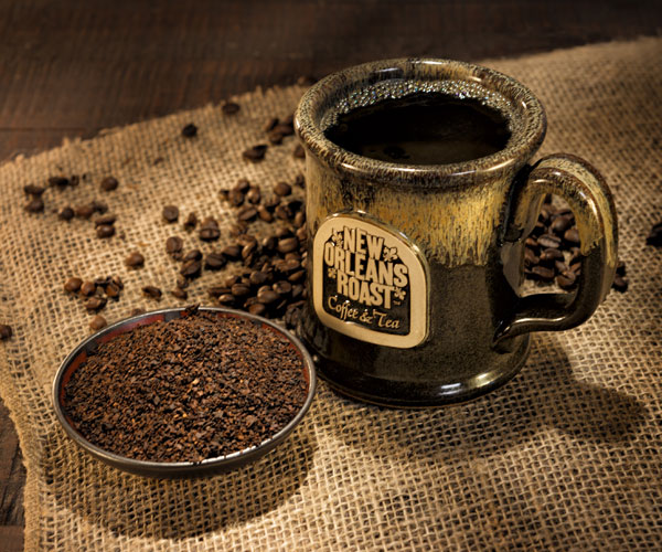 Cup of New Orleans Roast coffee with bowl of chicory