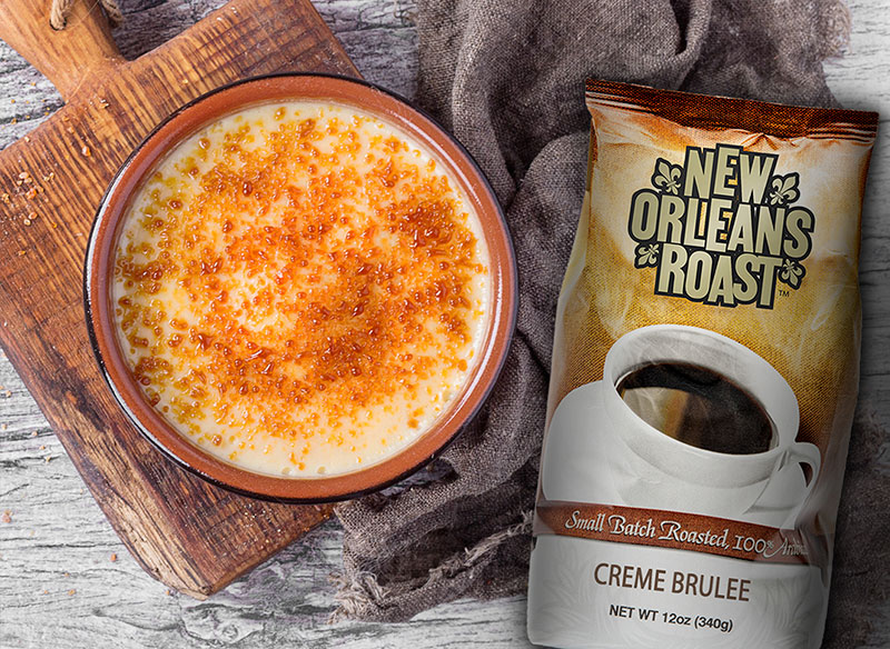Photo of Creme Brulee coffee bag next to cup of coffee