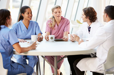 Health professionals pictures at table drinking coffee